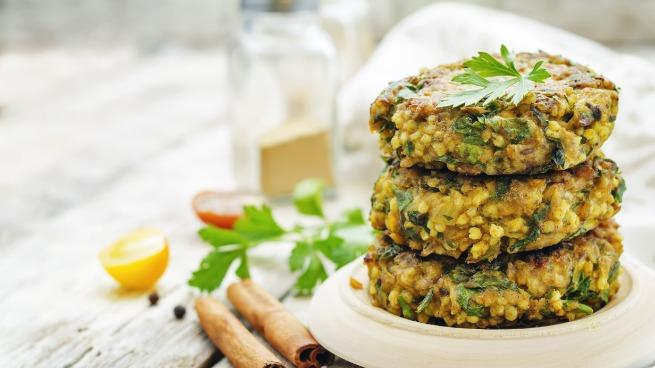 spicy vegan curry burgers with millet, chickpeas and herbs