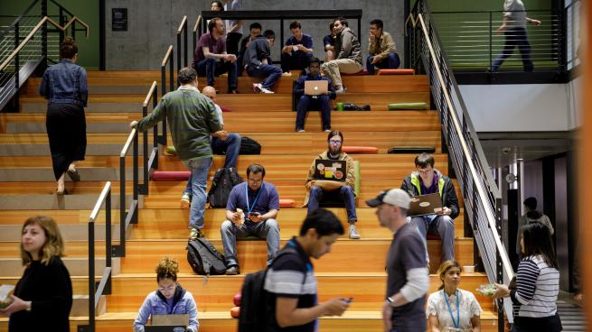 Amazon workers sitting on a set of stairs at the company's campus in Seattle