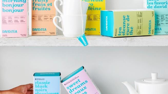 A shelf of DavidsTea boxes, tea cups and tea pot