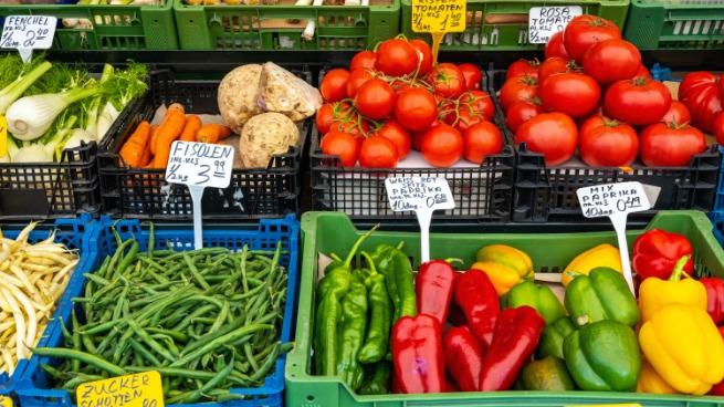 Rich selection of vegetables and salad for sale at an outdoor market