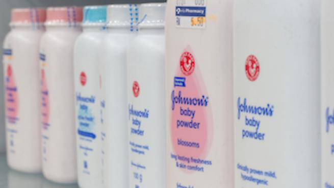 A store shelf lined with Johnson & Johnson talc products
