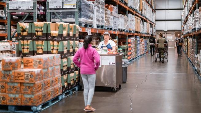 Costco wholesale warehouse shopping aisle with food testing