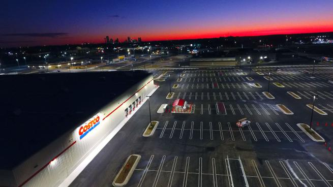 A night time aerial shot of a Costco store and parking lot in Ontario